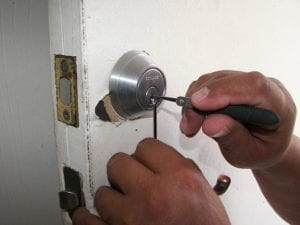locksmith near me at work picking a lock when locked out